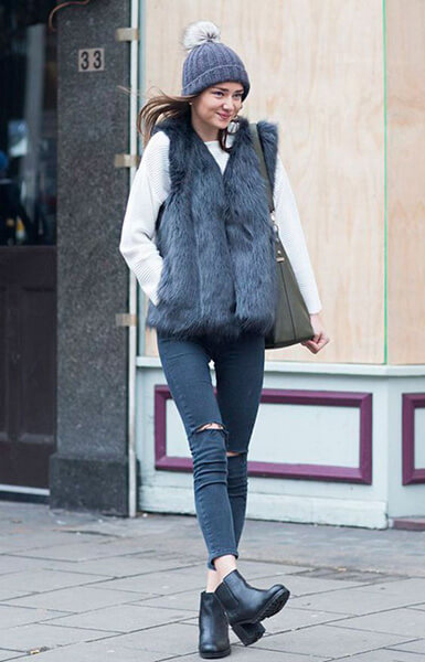 Looks with tractor boots and furry vest