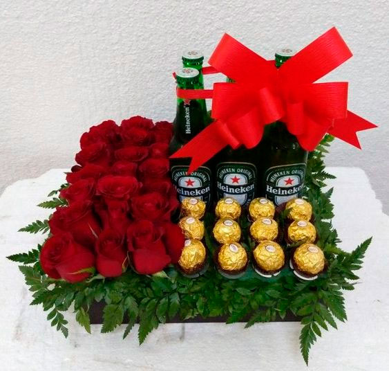 Basket with beer, roses and chocolates for mom