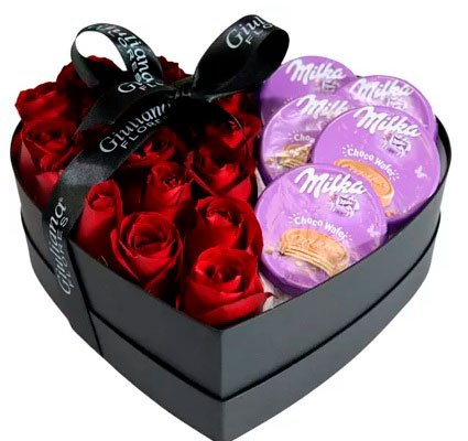 Basket of chocolates for girlfriend with roses and Milka