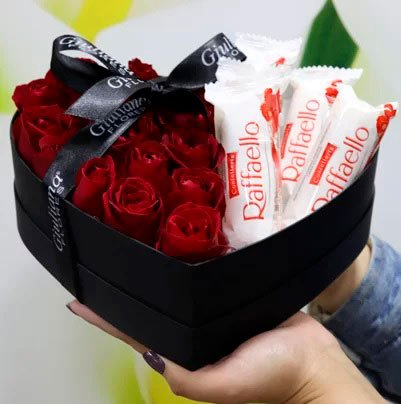 Basket of chocolates for girlfriend with Raffaello and roses
