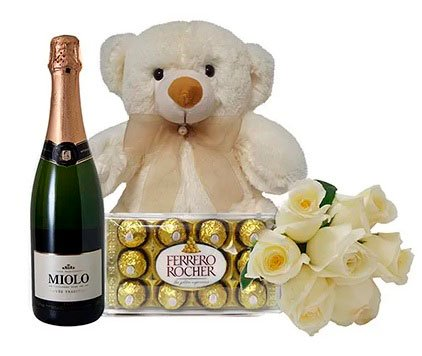 Teddy bear, flowers, chocolate and champagne for boyfriend